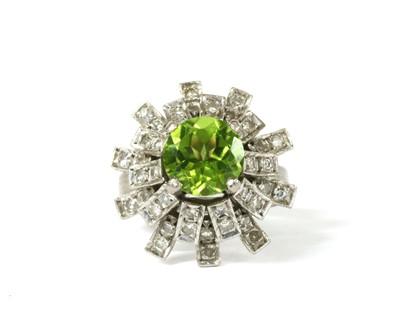 Lot 193 - A white gold peridot diamond cluster ring