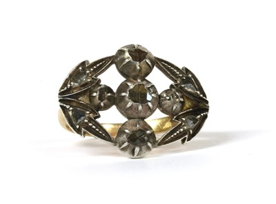 Lot 105 - A silver and gold, rose cut diamond cluster