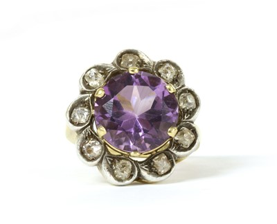 Lot 156 - A silver and gold, amethyst and diamond cluster ring