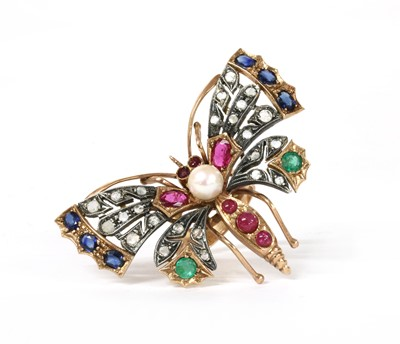 Lot 134 - A gold and silver, diamond and assorted gemstone butterfly ring