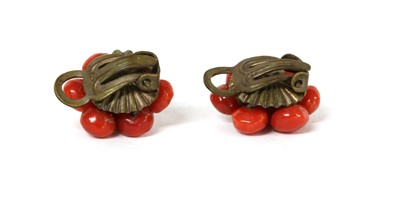 Lot 48 - A pair of metal coral cabochon cluster earrings