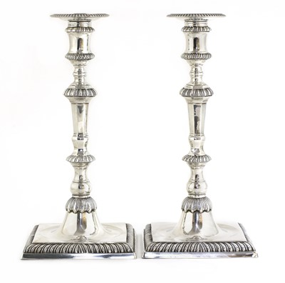 Lot 495 - A pair of cast silver candlesticks