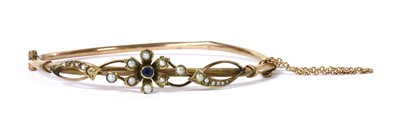 Lot 1025 - An Edwardian gold sapphire and split pearl bangle