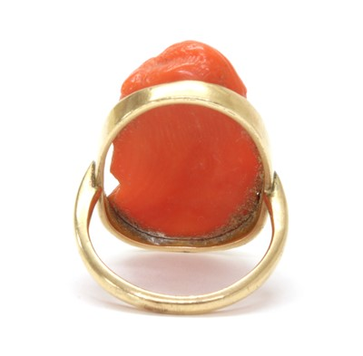 Lot 24 - A gold carved coral cameo ring