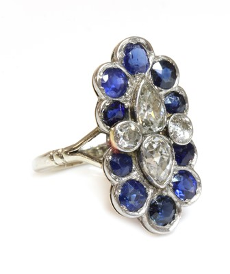 Lot 151 - A diamond and sapphire fingerline cluster ring, c.1935