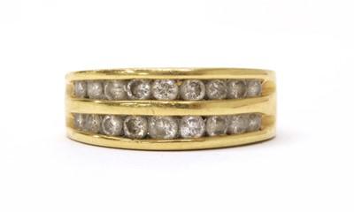 Lot 49 - A gold two row diamond set half eternity ring
