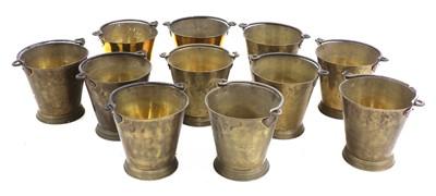Lot 106 - A set of eleven brass buckets