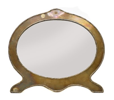 Lot 54 - An oval silver easel dressing mirror