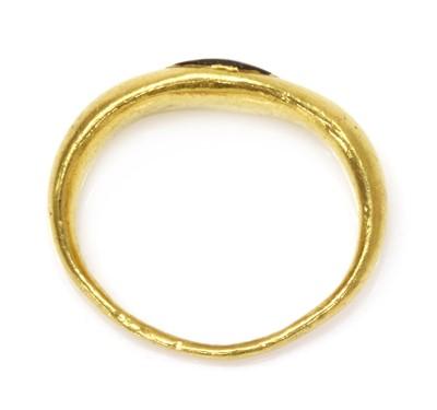 Lot 7 - A Roman high carat gold garnet intaglio ring