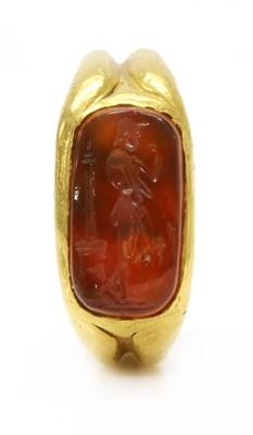 Lot 3 - A high carat gold carved cornelian intaglio ring