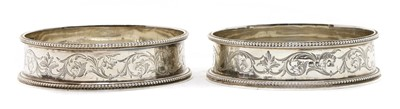 Lot 108 - A pair of Victorian silver coasters
