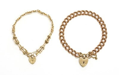 Lot 102 - A 9ct gold double curb link bracelet