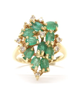 Lot 143 - A gold emerald and diamond cluster ring