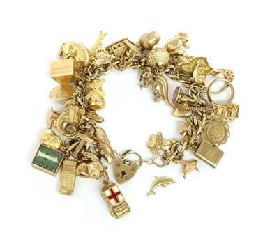 Lot 96 - A gold charm bracelet