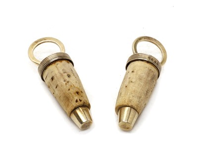 Lot 16 - Two antique silver and cork bottle stoppers