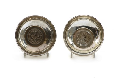 Lot 104 - Two silver coloured metal bowls