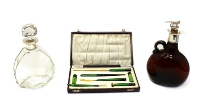Lot 27 - Two silver topped decanters