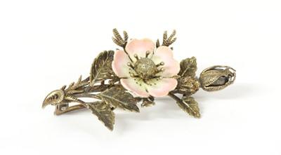 Lot 40 - A Continental Art Nouveau silver gilt enamel flower brooch