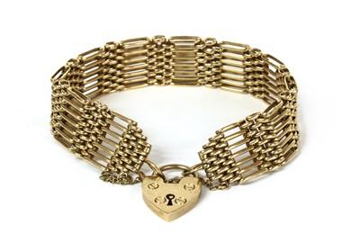 Lot 100 - A 9ct gold seven row gate bracelet