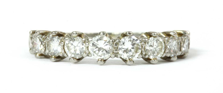 Lot 67 - A platinum diamond half eternity ring, c.1950