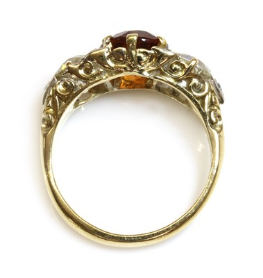 Lot 38 - A late Victorian citrine and diamond boat shaped carved head ring