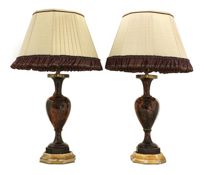 Lot 2 - A pair of polished hardstone table lamps