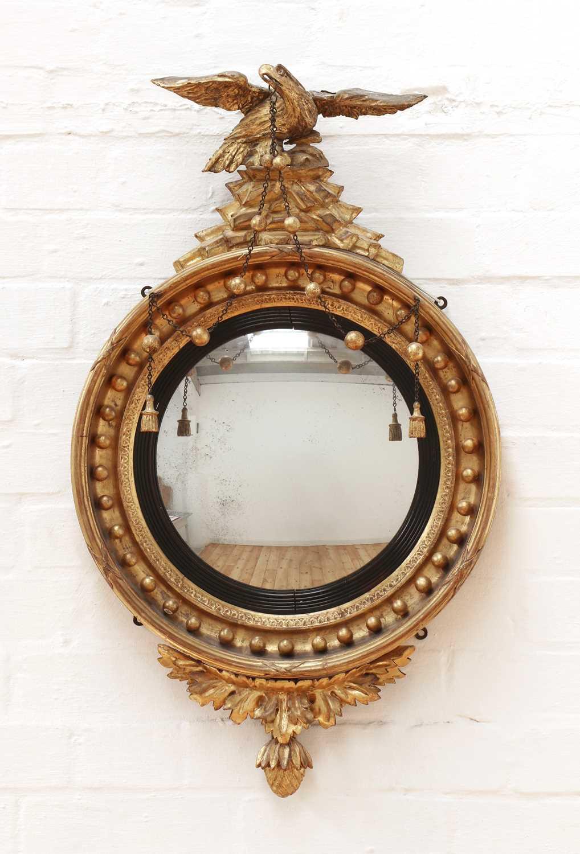 Lot 10 - A Regency giltwood convex mirror