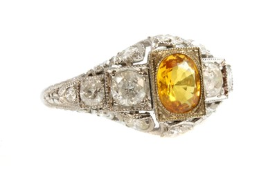 Lot 160 - An Art Deco style yellow sapphire and diamond ring