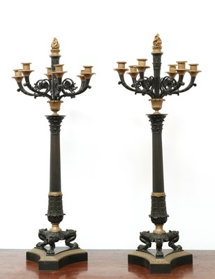 Lot 21 - A pair of large gilt and patinated bronze seven-light candelabra
