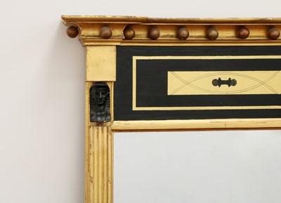 Lot 22 - A Regency Egyptian Revival giltwood pier mirror