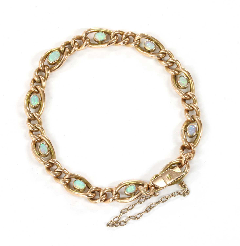 Lot 6 - An Edwardian gold opal set curb bracelet