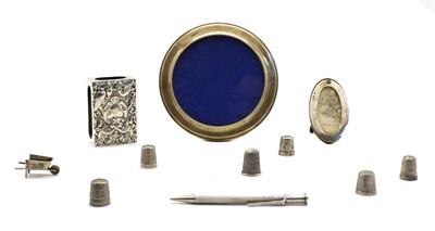 Lot 14 - A collection of novelty silver items