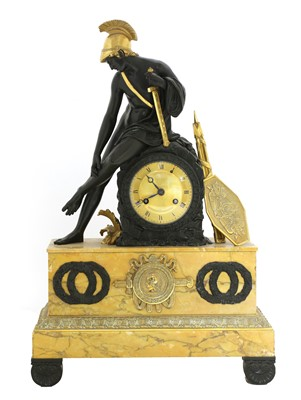 Lot 52 - A French Empire patinated and gilt-bronze and Sienna marble mantel clock