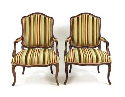 Lot 31 - A pair of French Louis XV beech fauteuils