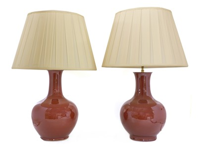 Lot 43 - A pair of Chinese-style porcelain sang-de-boeuf table lamps