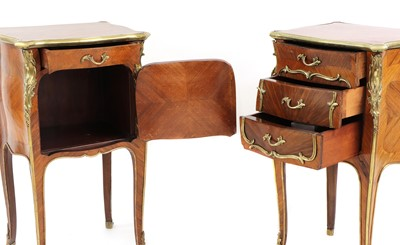 Lot 60 - A pair of French Louis XV-style kingwood and ormolu night tables
