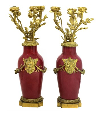Lot 59 - A pair of ormolu-mounted pink ground vase lamps
