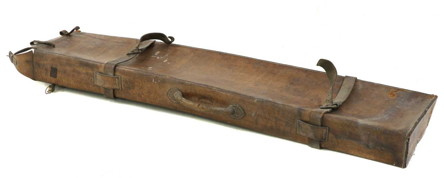 Lot 77 - A vintage leather gun carrying case