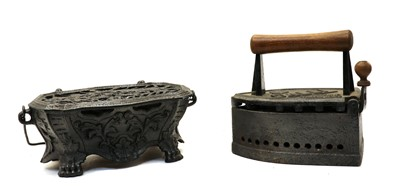 Lot 68 - A coachman's cast iron foot warmer