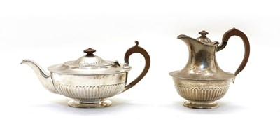 Lot 51 - A silver teapot and hot water jug