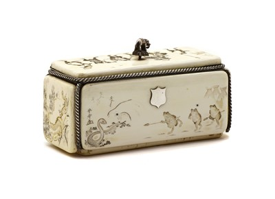 Lot 69 - A Japanese carved ivory and silver mounted box