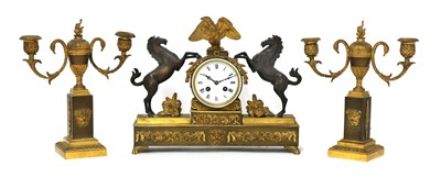Lot 482 - A French two-colour gilt-bronze three-piece clock garniture