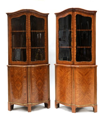Lot 632 - A pair of French Louis XVI kingwood corner cupboards