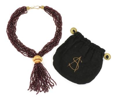 Lot 117 - A gold and silver, garnet tassel necklace, by Sandra D'Auriol