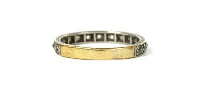 Lot 2 - A platinum and gold diamond eternity ring