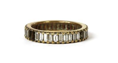 Lot 51 - A gold diamond set full eternity ring