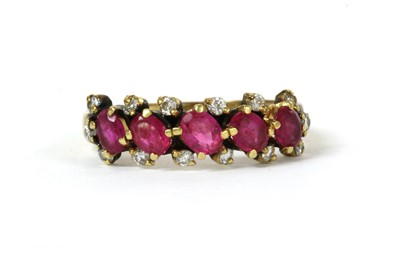 Lot 112 - A gold ruby and diamond ring