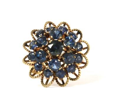 Lot 128 - A gold sapphire bombé cluster ring