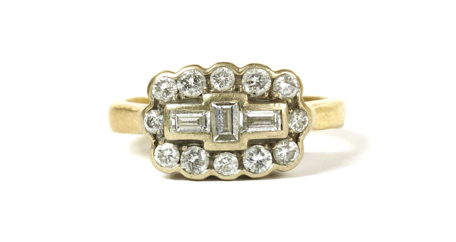 Lot 50 - A gold diamond cluster ring