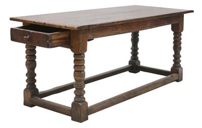 Lot 214 - An oak refectory table